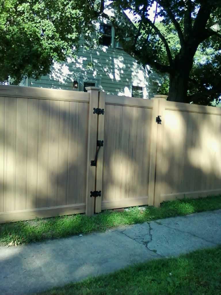 Woodgrain Vinyl Fences Gates Amp Railings Liberty Fence
