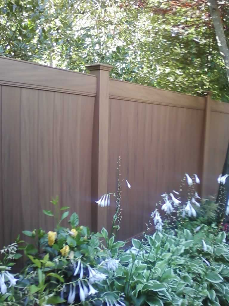 Woodgrain Vinyl Fences Gates Amp Railings Liberty Fence