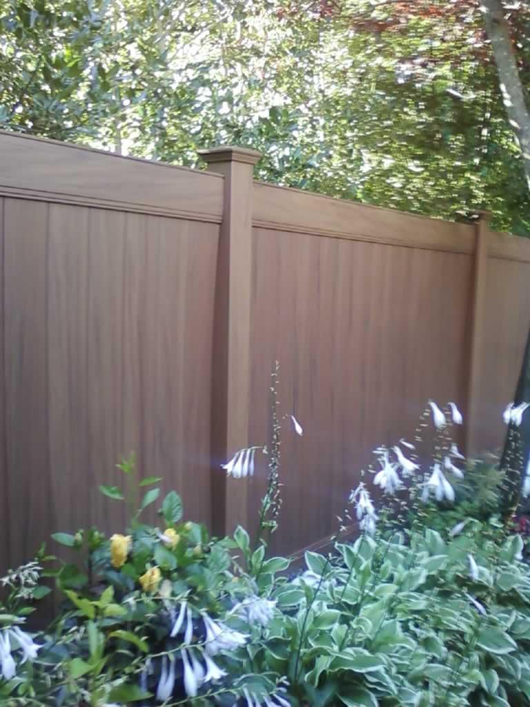 Woodgrain Vinyl Fences Amp Gates Liberty Fence Amp Railing